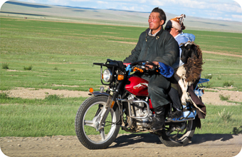 Nomads on motorbike with their sheep
